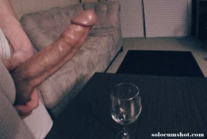 Big cock jerking off into a wine glass