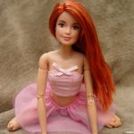 Sexy Redhead Barbie on her knees