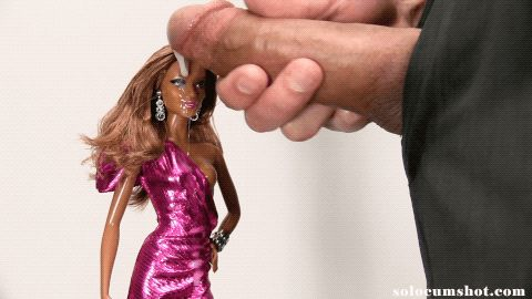 Cumshot on black barbie