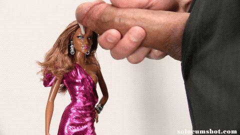 Cumshot on black barbie