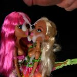 Cumming on 2 dolls